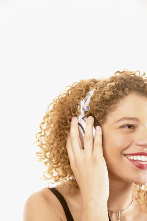 credence: Young woman smiling holding a headset