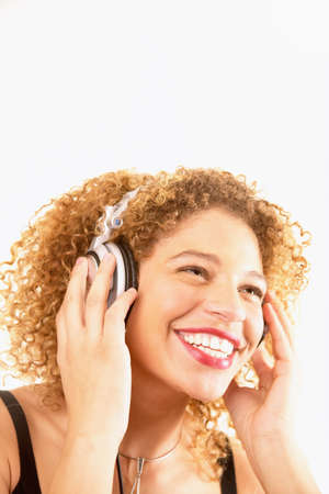 chirpy: Young woman wearing headphones smiling