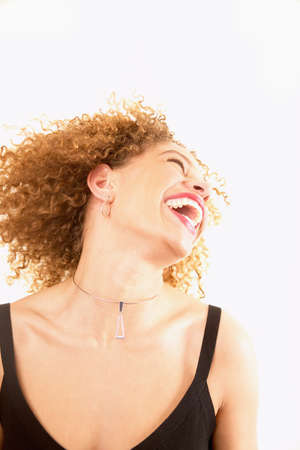 exuberant: Young woman smiling with her head thrown back