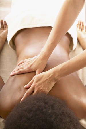 Woman receiving a back massage Stock Photo - 16045592