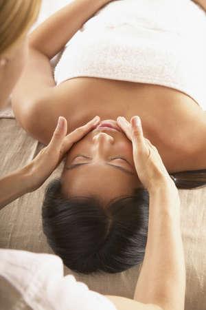 Woman receiving a facial massage Stock Photo - 16045597