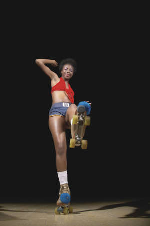 native african ethnicity: Portrait of young woman on roller skate