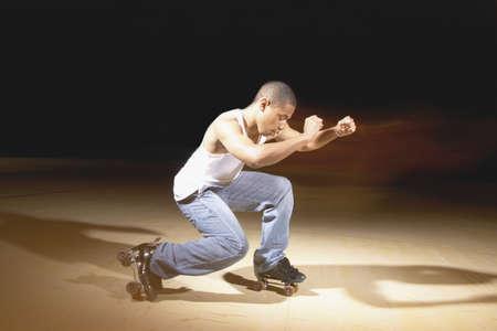 aplomb: Young man break dancing on roller skates