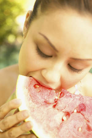 peccadillo: Young woman eating a watermelon slice