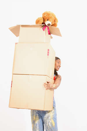 ebullient: A young woman carrying a stack of boxes