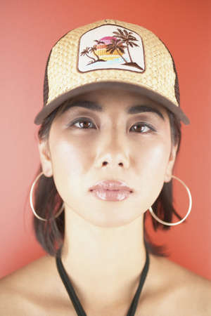 Portrait of a young woman wearing a baseball cap Stock Photo - 16045646