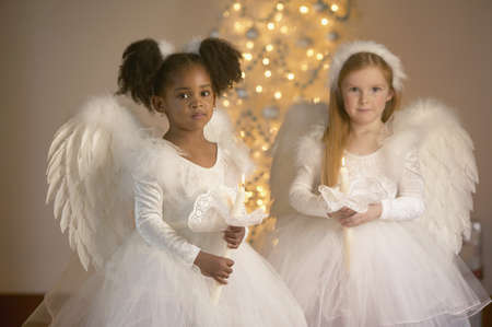 christmas costume: Portrait of two girls in fairy costumes