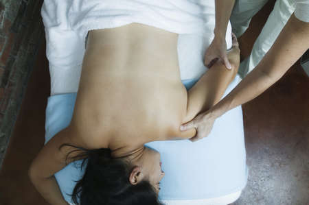 hair treatment: High angle view of a young woman getting a massage in a health spa