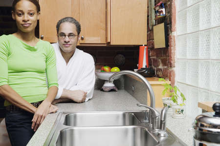 Portrait of a young couple standing in the kitchen Stock Photo - 16045786