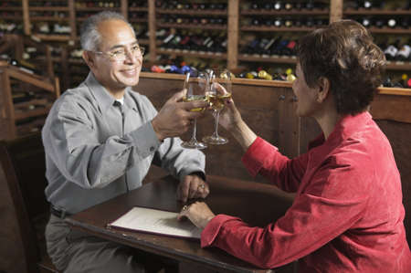 Side profile of a mature man drinking wine with a young woman Stock Photo - 16045814