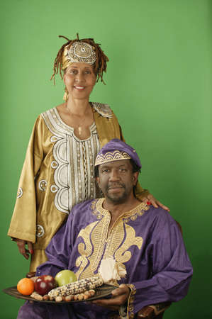 religious clothing: Portrait of a mature man with a young woman standing beside him
