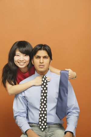 Close-up of a young couple choosing a tie Stock Photo - 16046020