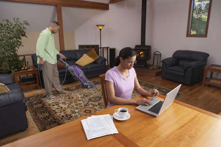 Young couple working at their home Stock Photo - 16046269