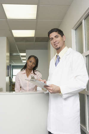 Portrait of a male doctor standing in front of a young woman Stock Photo - 16046311