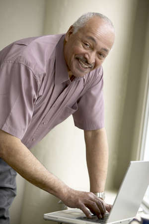 Close-up of a mature man using a laptop Stock Photo - 16046437