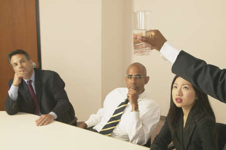 Business Executives sitting in a boardroom at a meeting Stock Photo - 16046558
