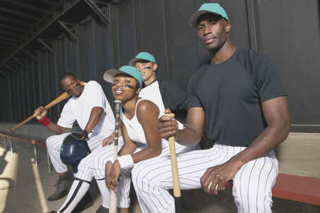 dugout: Portrait of baseball team sitting on a bench