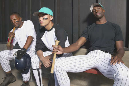 Portrait of baseball team sitting on a bench Stock Photo - 16046578