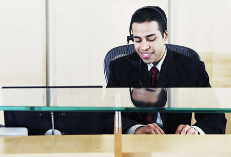 Businessman using a computer in an office Stock Photo - 16046690