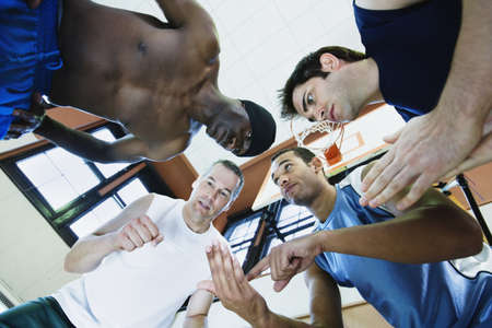Low angle view of a group of basketball players discussing Stock Photo - 16046700