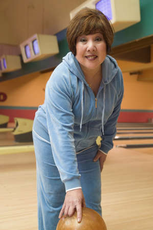 Portrait of a mature woman bowling Stock Photo - 16046775