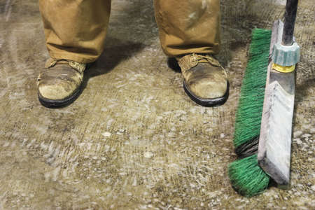 low section view: Low section view of a male construction worker with a mop LANG_EVOIMAGES