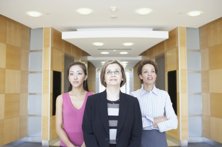 Three businesswomen standing in a corridor Stock Photo - 16046957