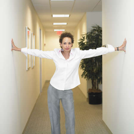 Portrait of a businesswoman standing in a corridor
