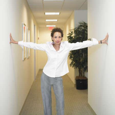 Portrait of a businesswoman standing in a corridor