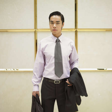 Portrait of a young businessman holding a briefcase Stock Photo - 16047085