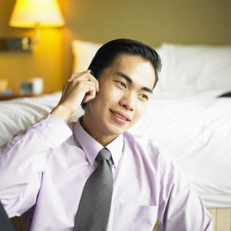 young businessman talking on a mobile phone Stock Photo - 16047090