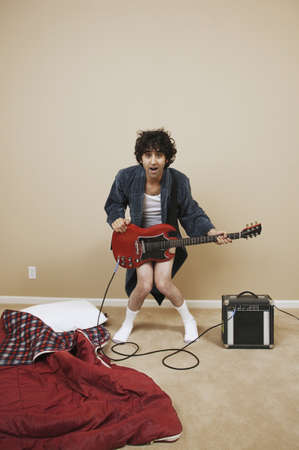 Portrait of a young man playing an electric guitar Stock Photo - 16047114