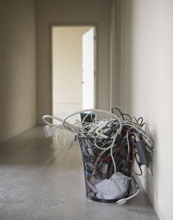 Garbage bin filled with computer cables and waste materials Stock Photo - 16047188