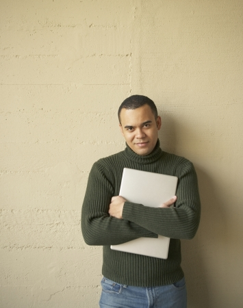 Portrait of a young man holding a file Stock Photo