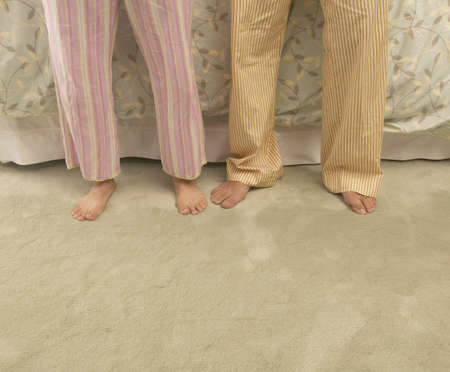 striped pajamas: Low section view of two people standing together