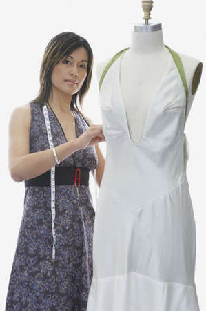 designer: Portrait of a fashion designer with a mannequin