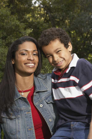 Portrait of a mother and her son smiling Stock Photo - 16047334