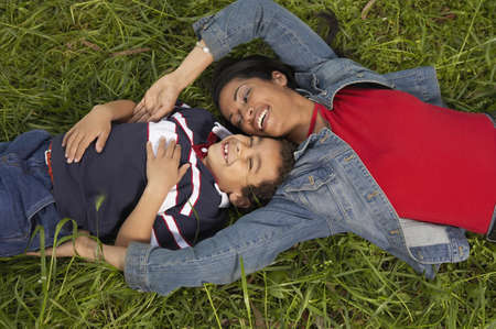 High angle view of mother and her son lying on the grass Stock Photo - 16047338