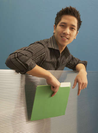 Portrait of a businessman holding a file in an office Stock Photo - 16047342