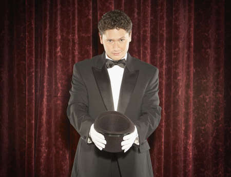Portrait of a magician performing magic tricks on stage Stock Photo - 16047350