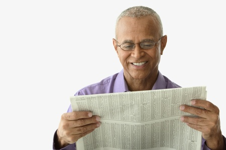 Close-up of a mature man reading a newspaper Stock Photo - 16047360