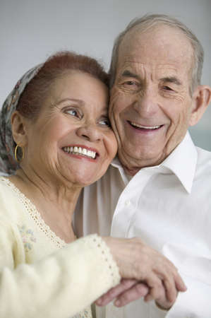 only senior women: Senior couple smiling and holding hands