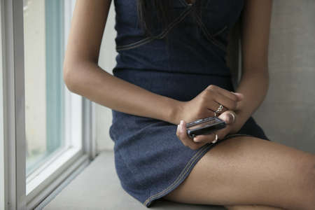 pager: Young woman holding a hand held device