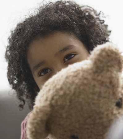 elementary age girl: Boy holding a teddy bear