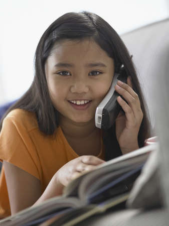 cordless phone: Portrait of a girl talking on a cordless phone