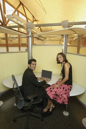 High angle view of a businessman and businesswoman sitting in an office