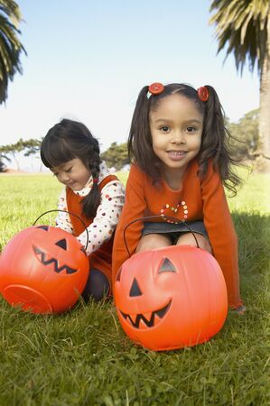 Girls playing with Halloween lanterns in a park Stock Photo - 16047635