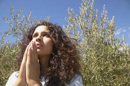 only one young adult woman: Low angle view of a young woman meditating
