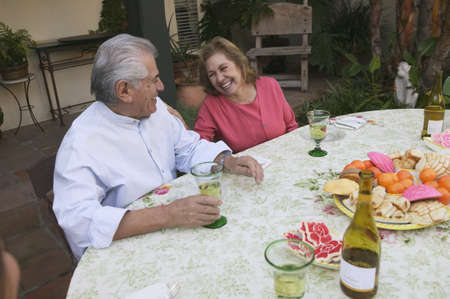 High angle view of a mature couple seated at a table Stock Photo - 16047720