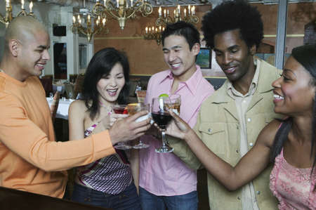 Group of people toasting glasses of wine in a nightclub Stock Photo - 16047721